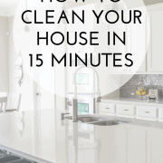 Picture of a clean, white kitchen with text overlay that says: How to Clean Your House in 15 Minutes