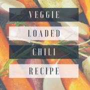 Picture of vegetables (carrots, red onion, yellow onion, garlic) with text overlay that says: veggie loaded chili recipe